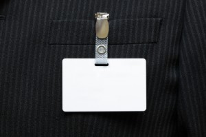 Blank identity tag hanging from a businessmans suit